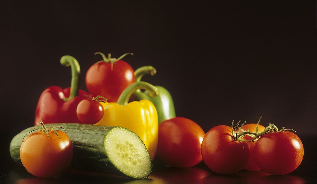 Still life with tomatoes, peppers and cucumber