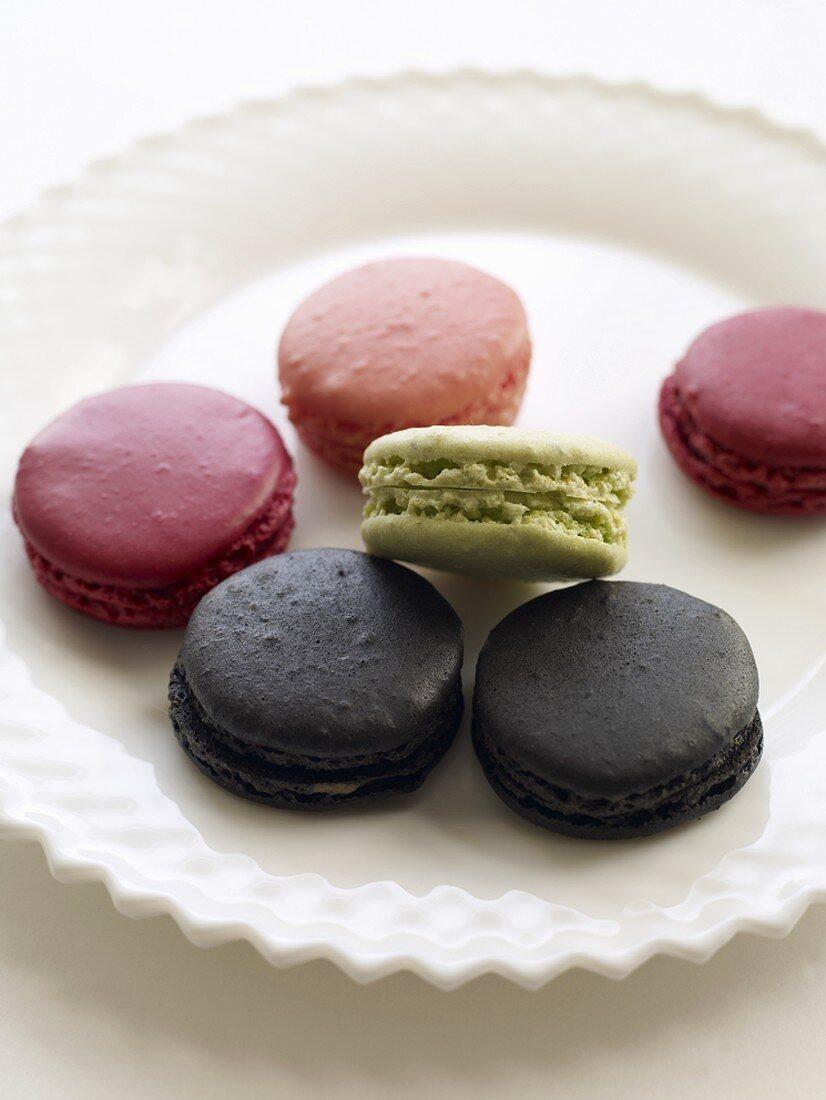 Liquorice, pistachio & berry macarons (small French cakes)