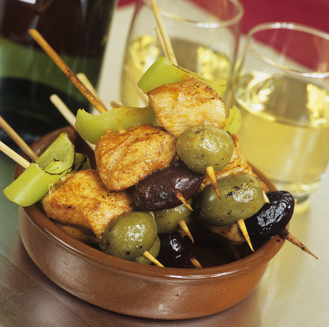 Tapas: chicken and olives on cocktail sticks