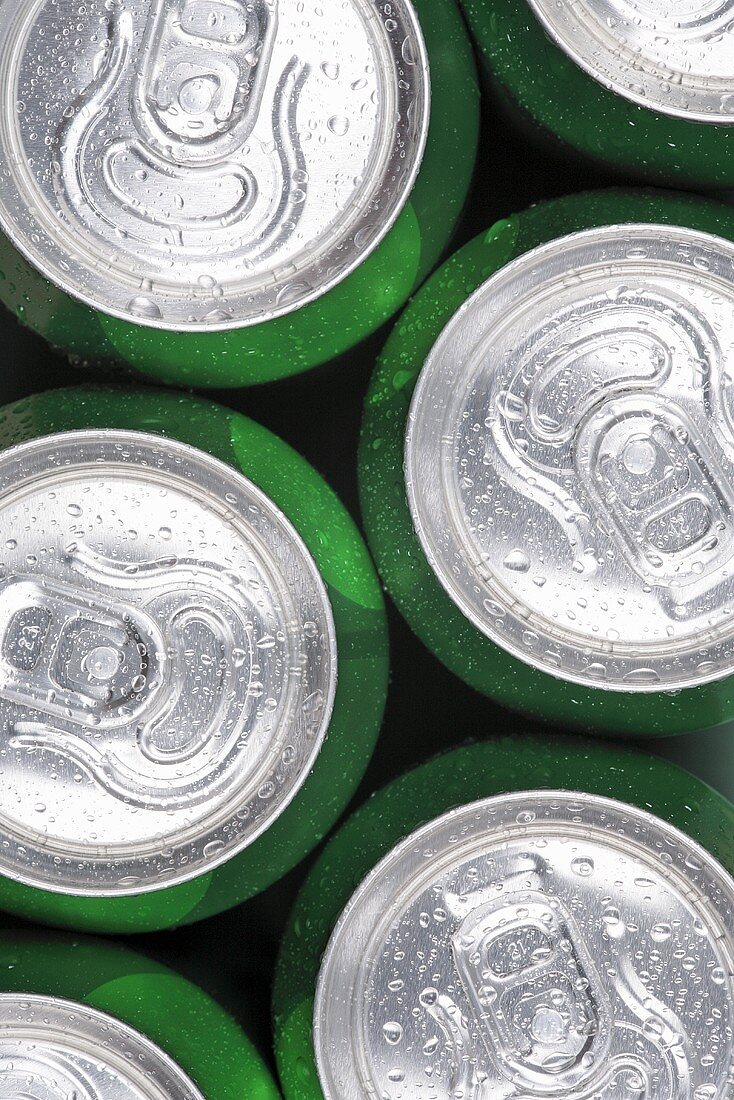 Green drink cans with drops of water