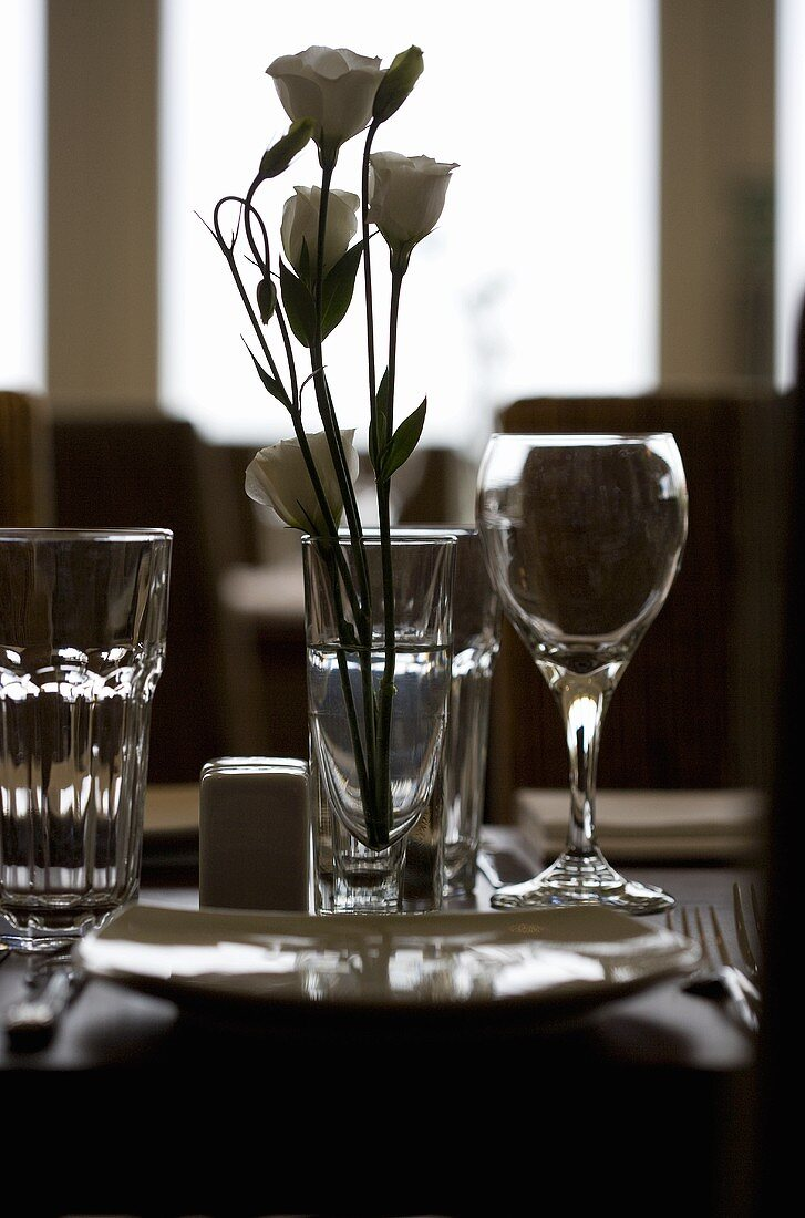 Laid table with roses in a restaurant