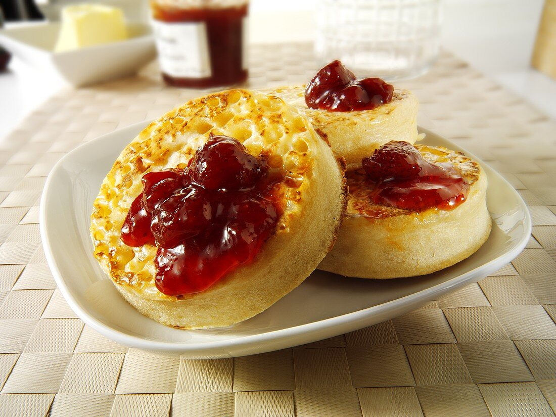 Crumpets with strawberry jam