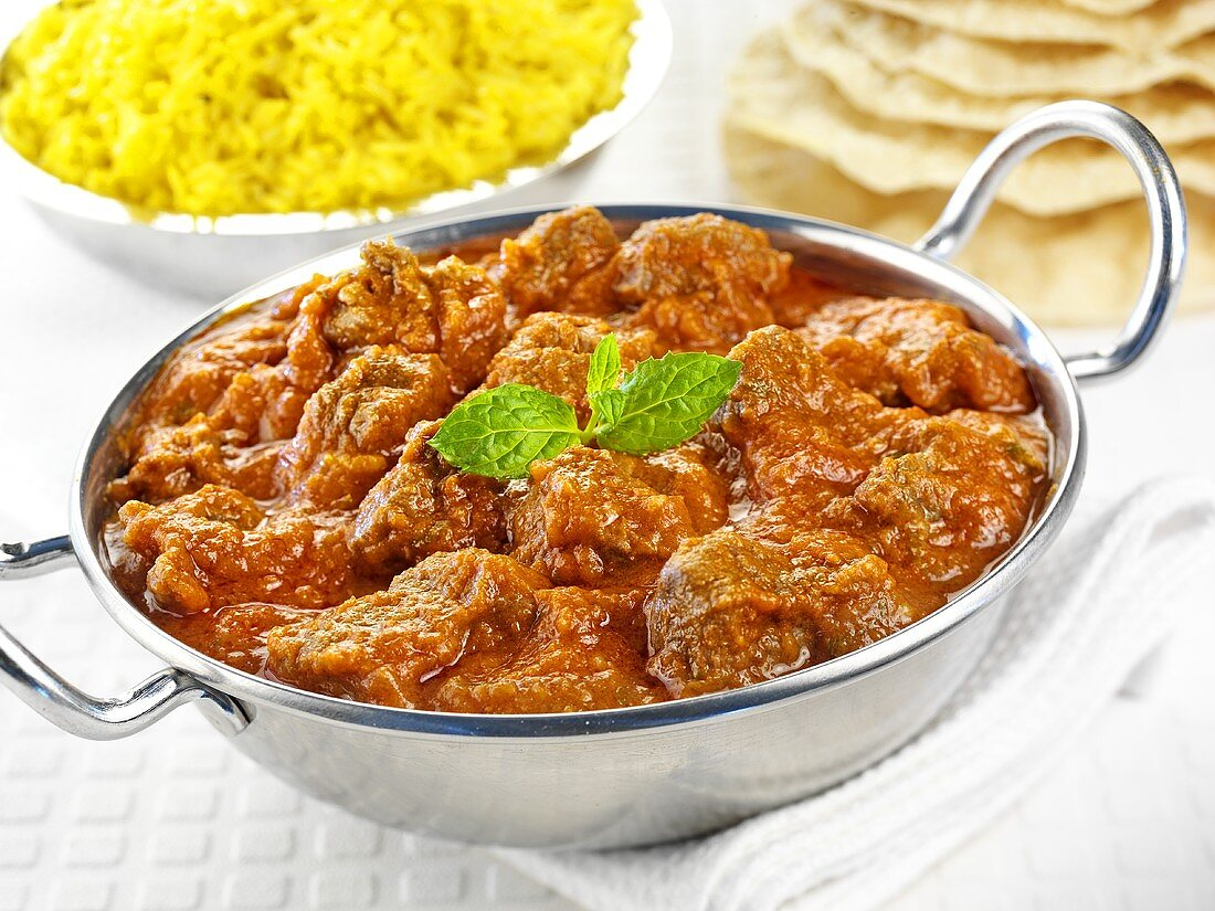 Rogan josh (Indian lamb curry) with saffron rice & flatbread