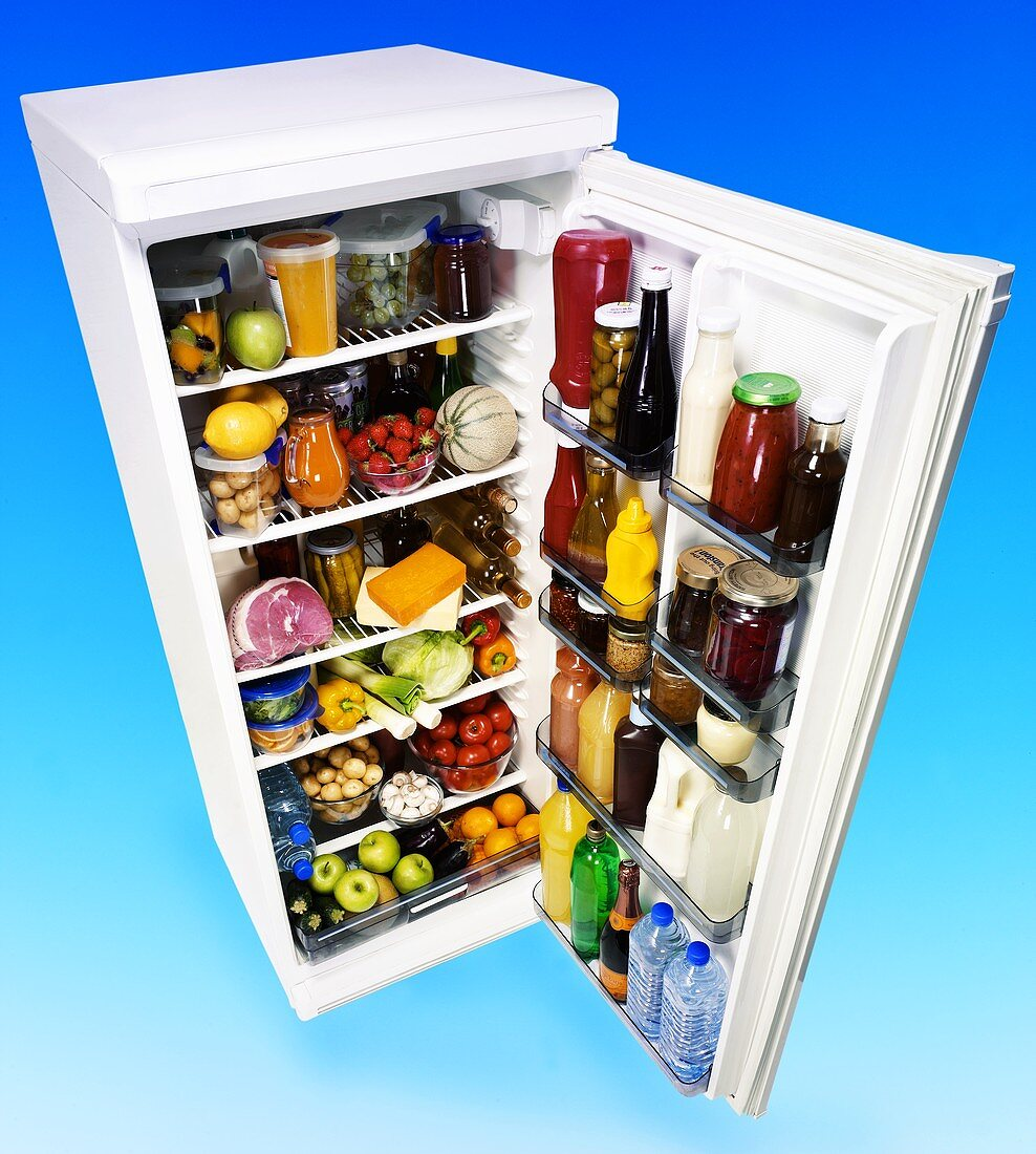 Open refrigerator full of food and drink