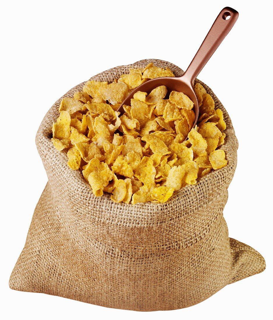Cornflakes in jute sack with scoop