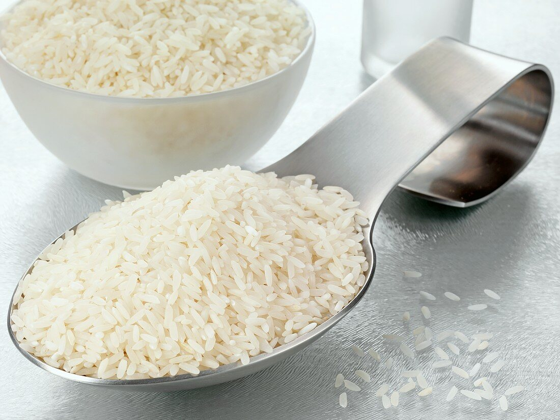 Long-grain rice on a spoon and in a bowl