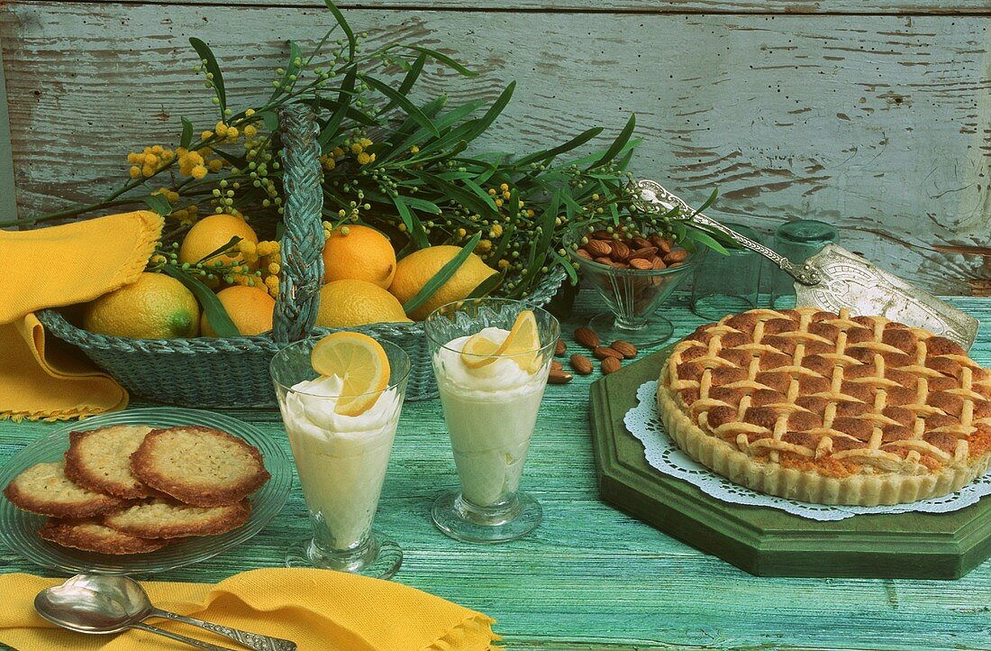 Almond cream tart (frangipane) and lemon posset with almond biscuits