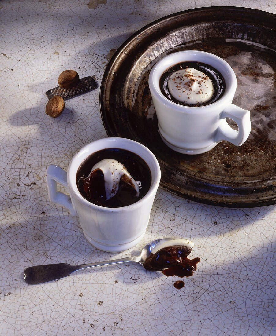 Warm espresso and chocolate creme in coffee cups