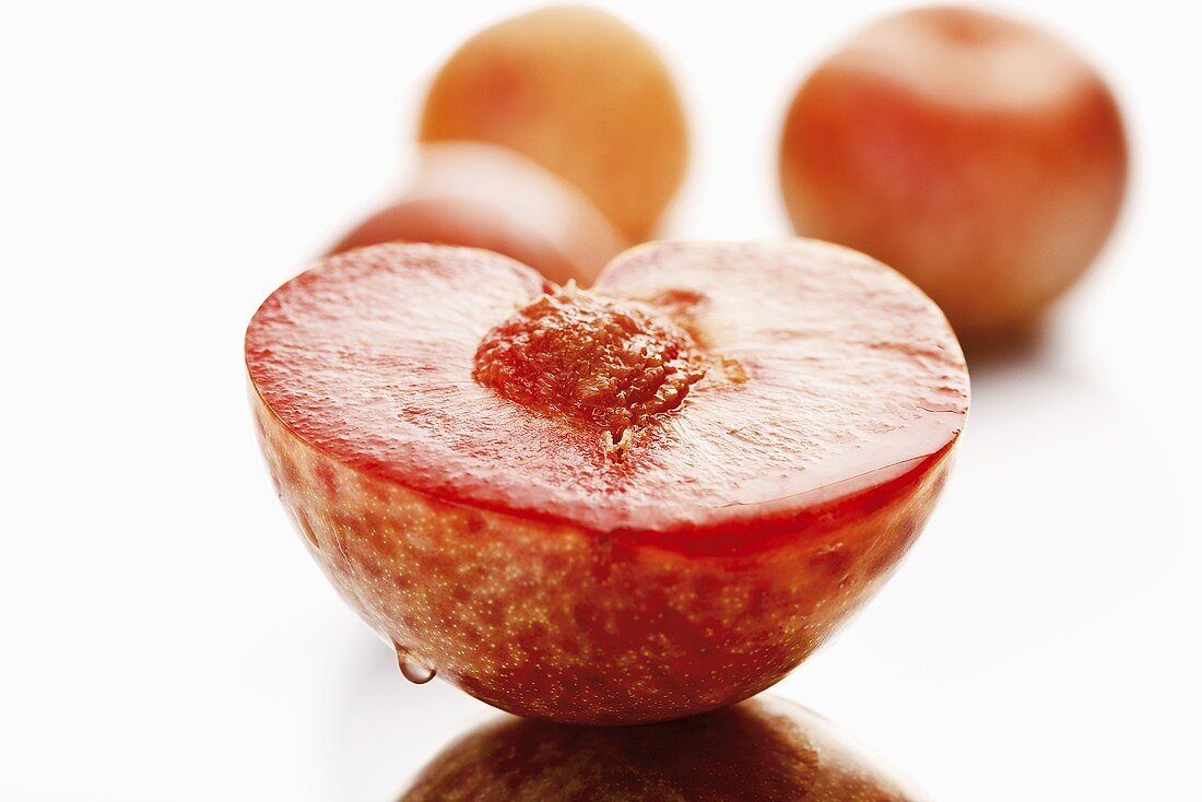 A halved pluot (cross between apricot and plum)