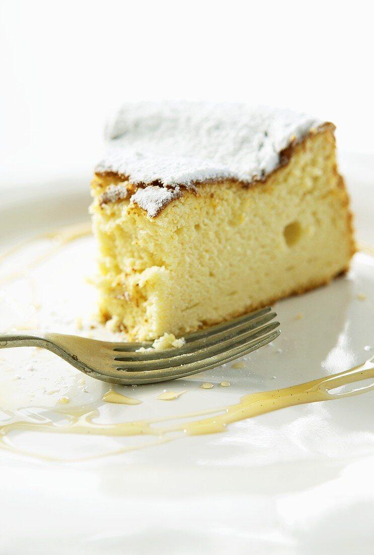 Piece of sweet olive cake, a bite taken