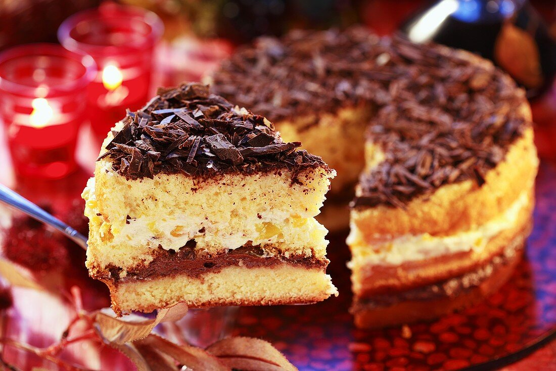 Sponge cake with chocolate shavings, a piece cut