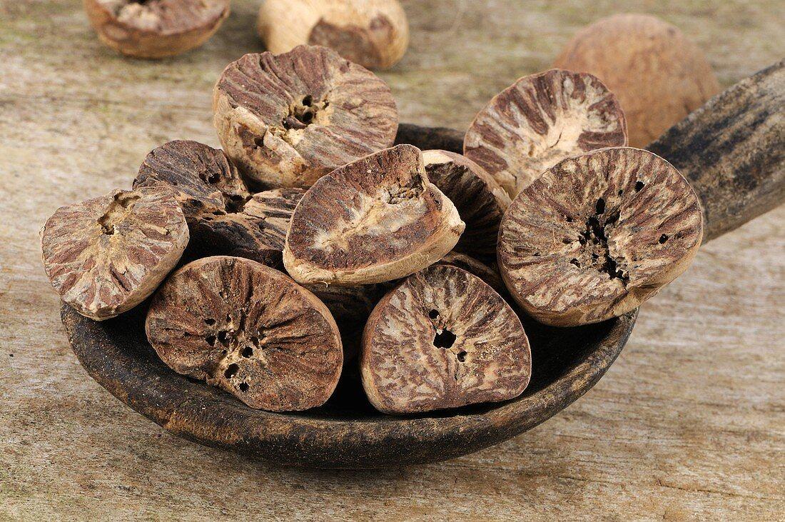 Betel nuts in a wooden spoon