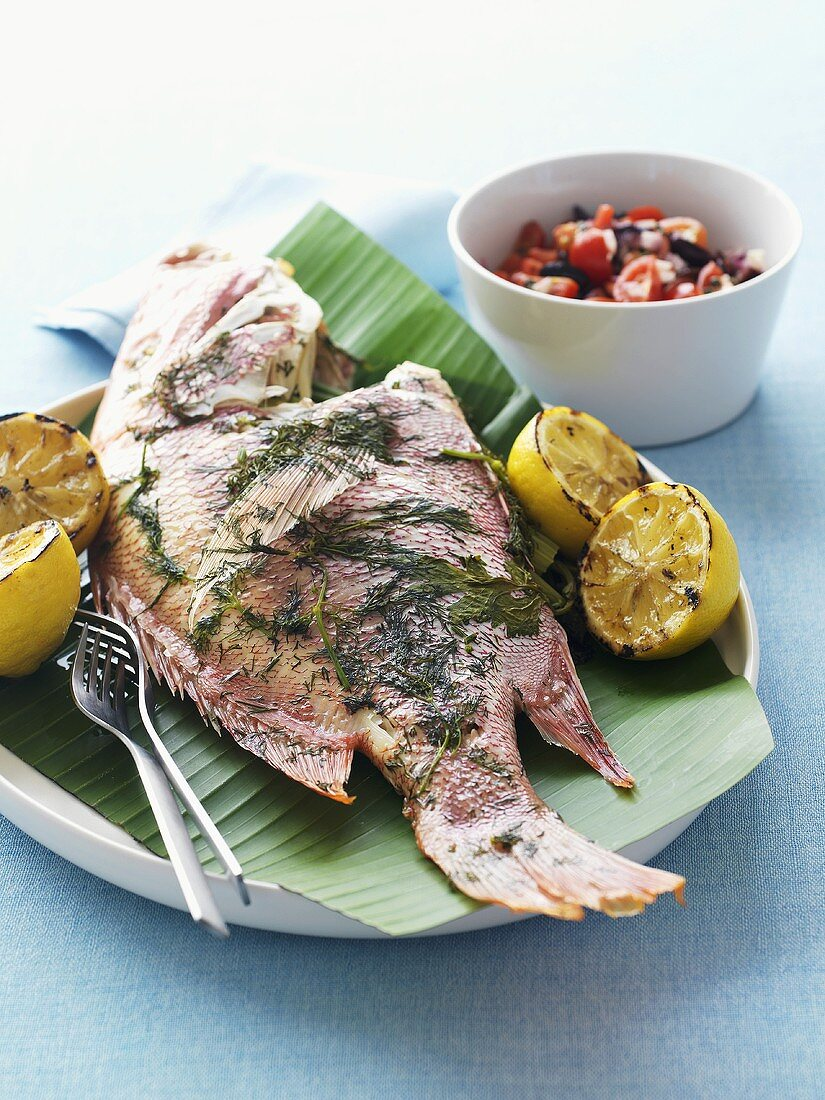 Grilled fish with lemons and salsa