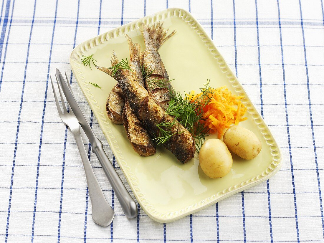 Baltic herrings with carrot salad and boiled potatoes