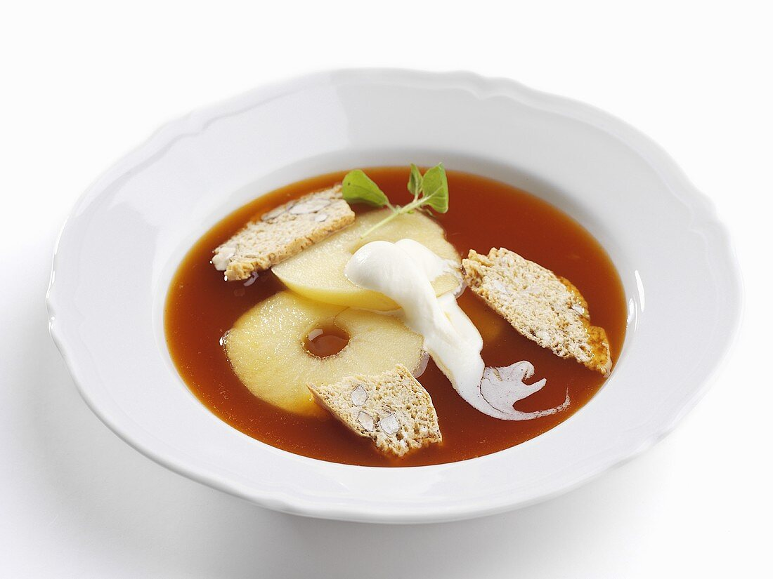 Warm rose hip soup with apple and whipped cream