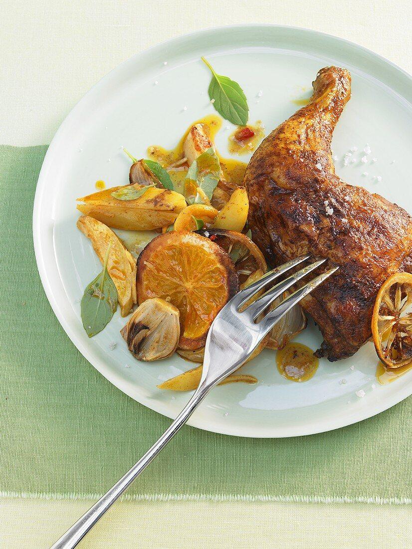 Marinated chicken legs with orange slices