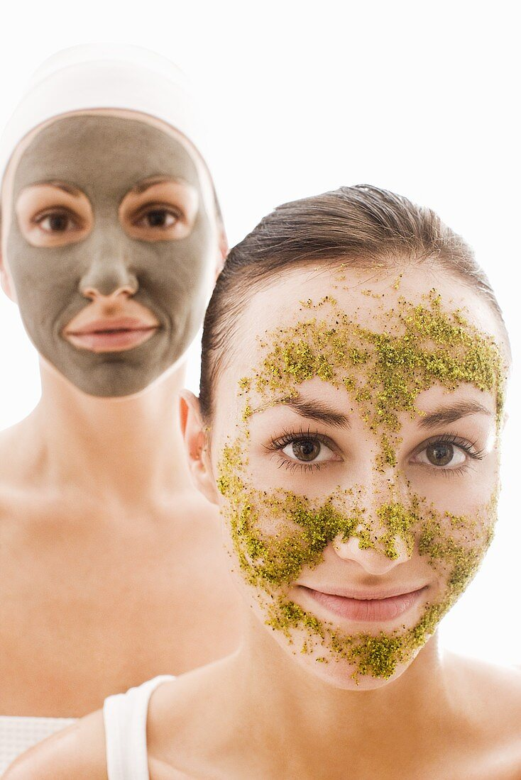 Two women with herbal and with healing clay facial masks