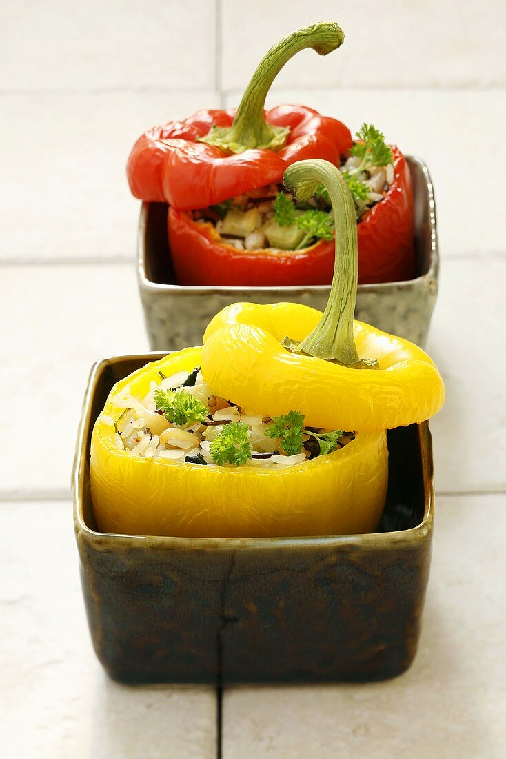Red & yellow peppers stuffed with rice, celery, pine nuts