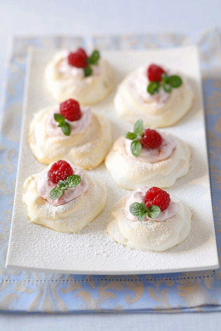 Meringues with strawberry cream and fresh raspberries