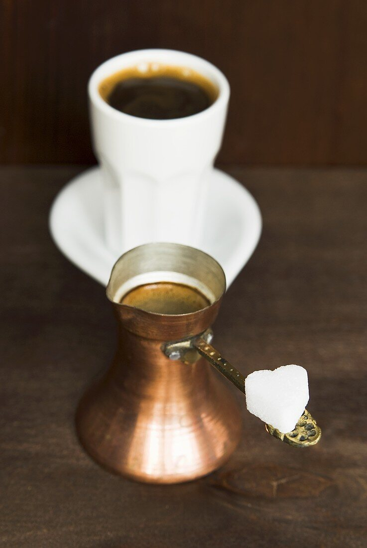 Middle Eastern coffee in a copper pot and a cup