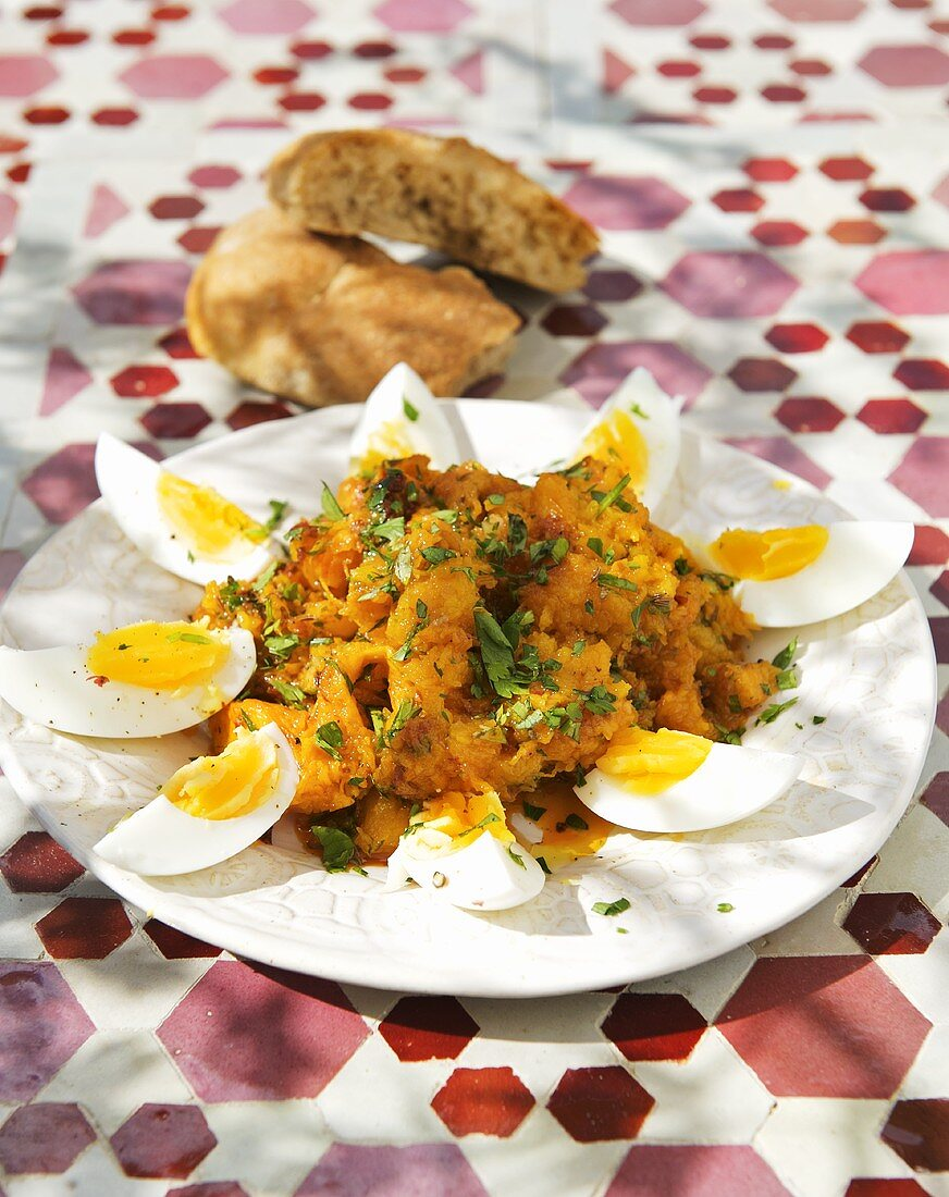 Pumpkin salad with garlic, harissa and caraway