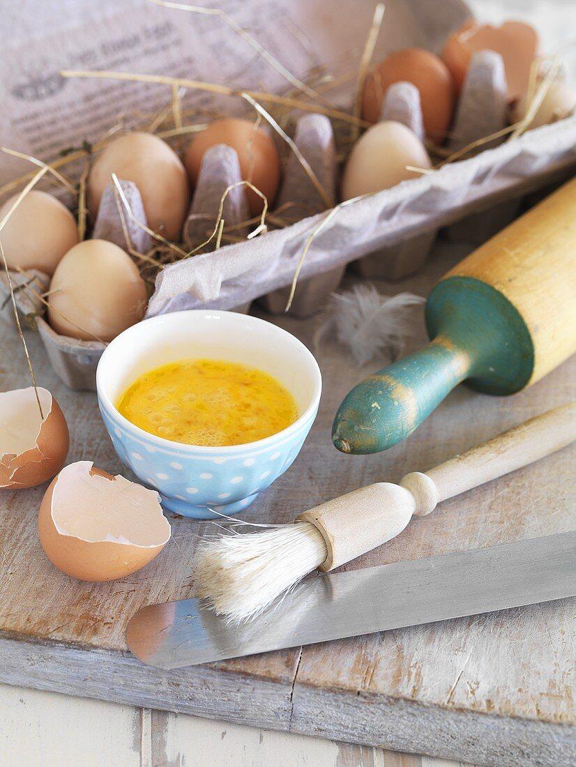 Baking ingredient: beaten eggs in a bowl, egg box