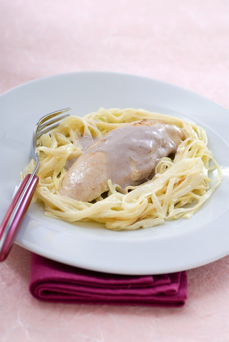 Turkey breast with port and cream sauce on pasta