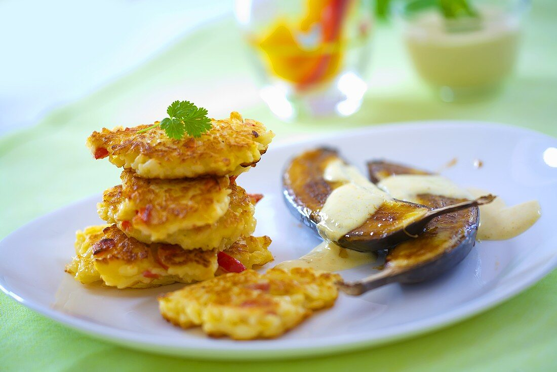 Fried aubergine with yoghurt sauce and vegetable pancakes