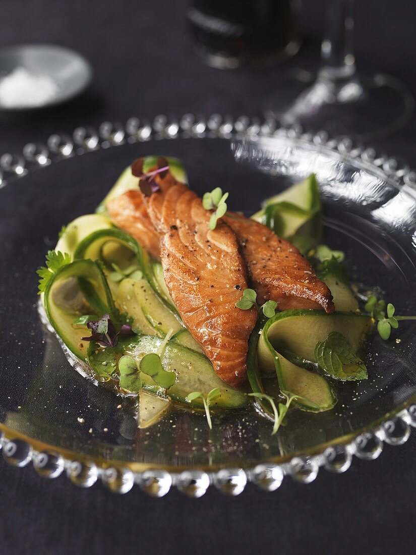 Teriyaki salmon on Japanese cucumber salad