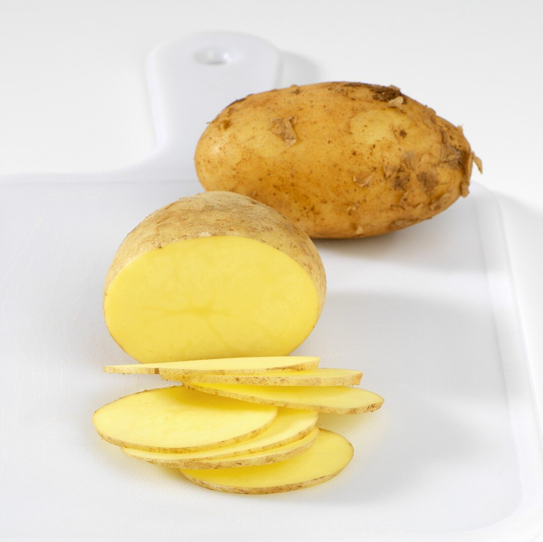 Potatoes, one whole, one partly sliced