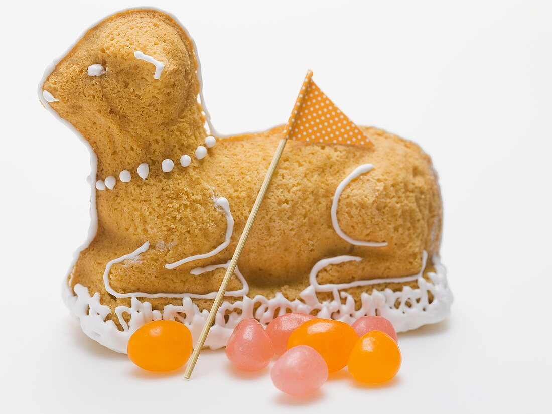 Sweet baked Easter lamb with flag and jelly beans