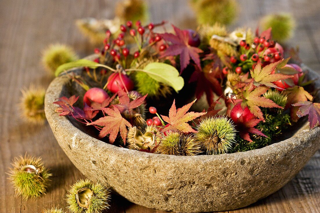 Wreath of crab apples, chestnuts, rose hips, Japanese maple twigs