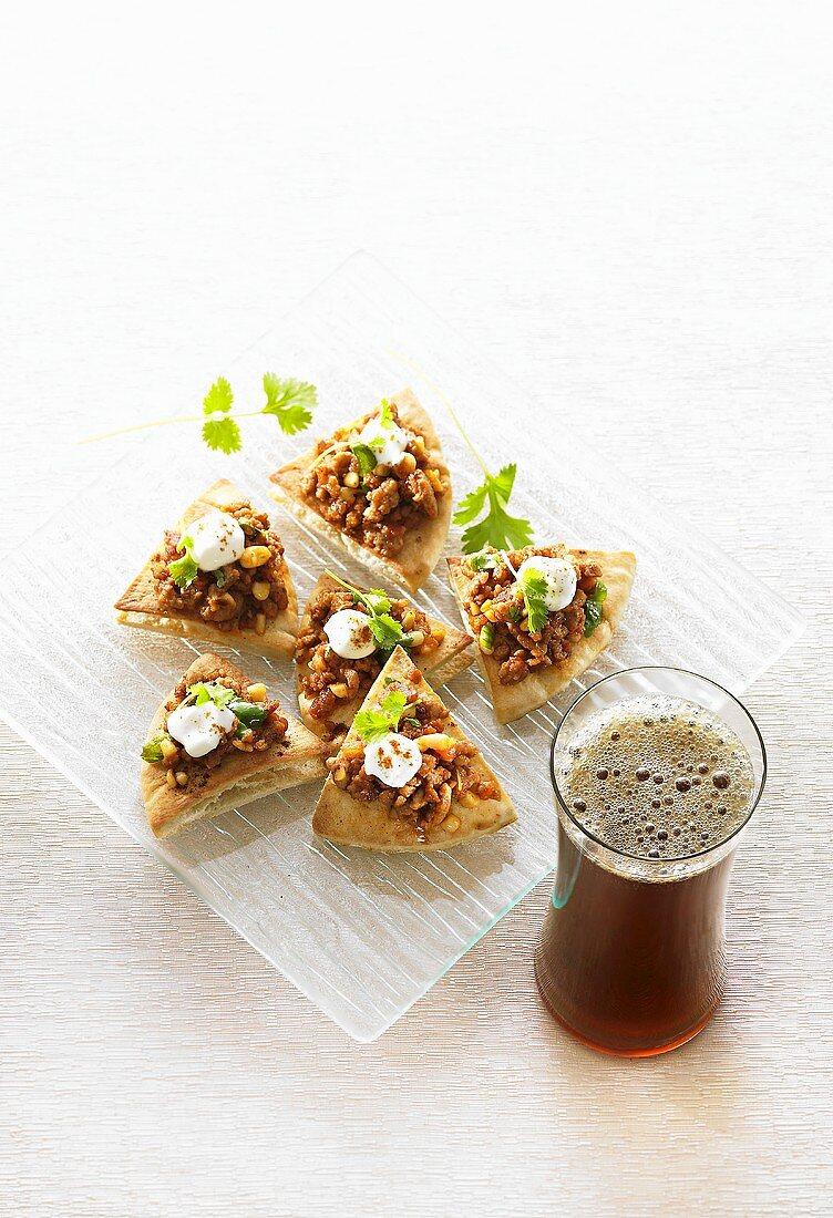 Lamb, pine nut & yoghurt appetisers, glass of Long Island Iced Tea