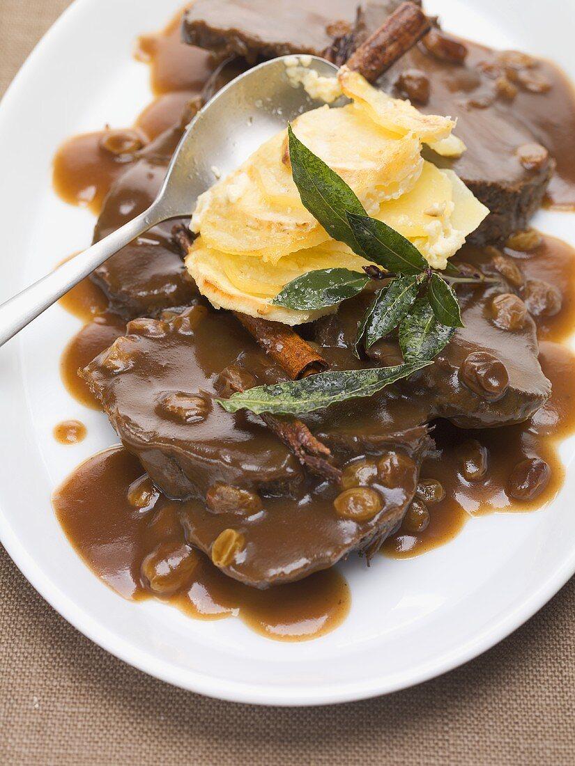 Rhineland-style marinated pot roast with potato gratin