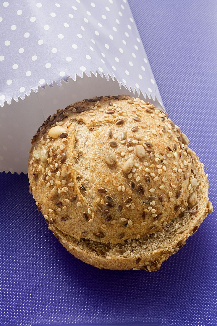 Wholemeal roll in paper bag