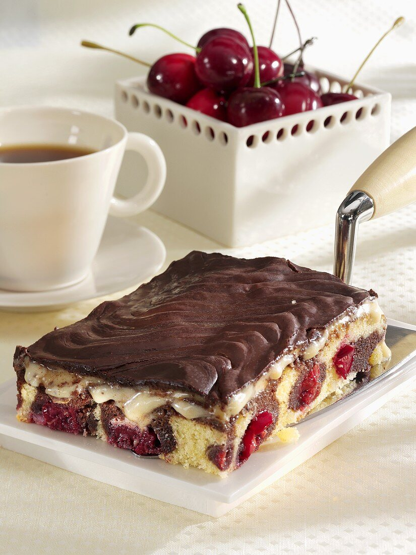 Danube Waves Cake on cake slice, cup of coffee