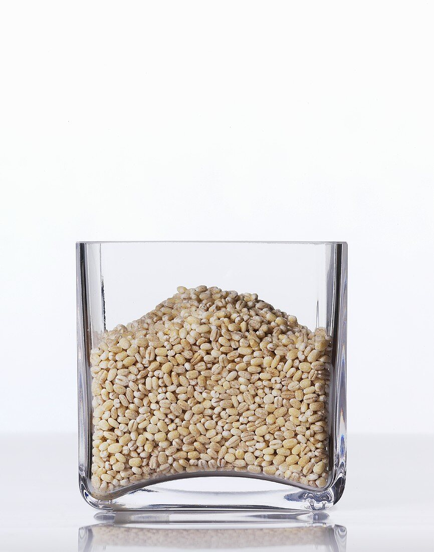 Pearl barley in a square glass
