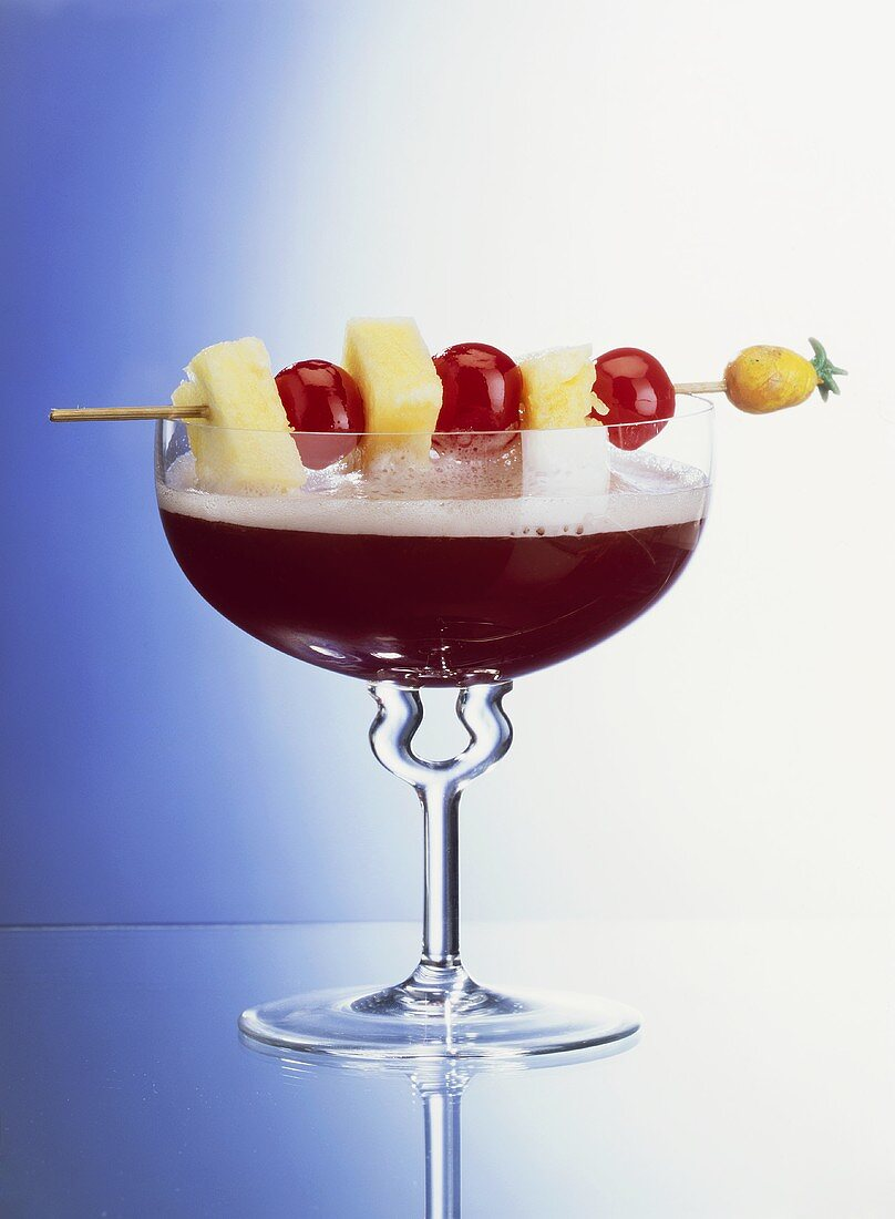 Red Kiss Champagne Cocktail with Skewered Fruit