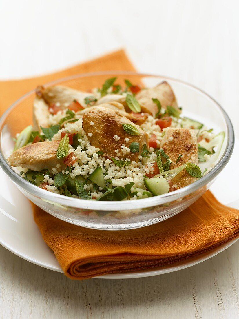 Fried chicken breast on couscous salad