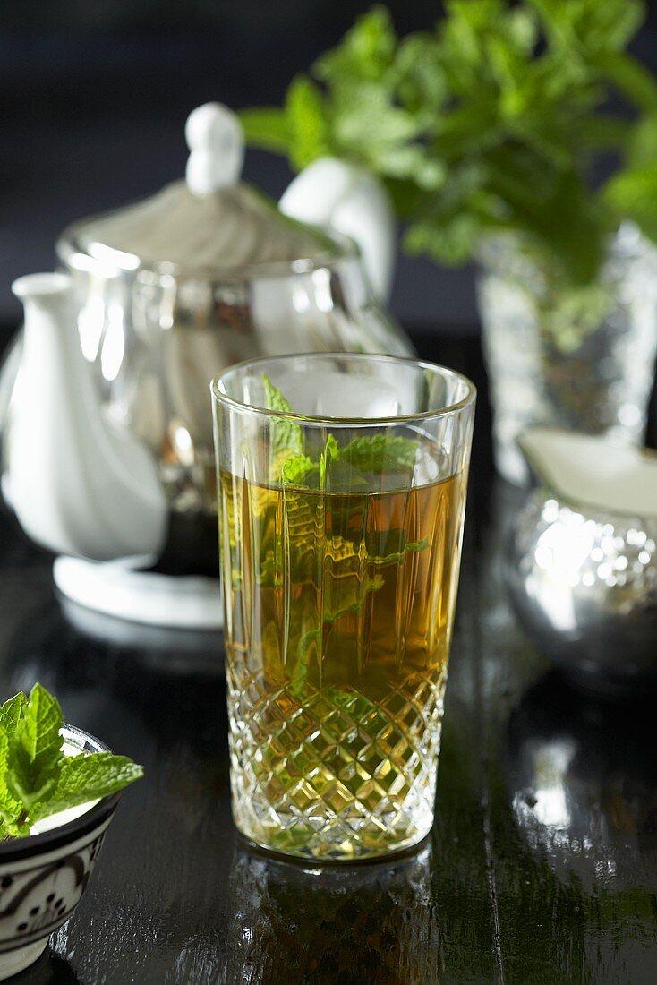 Mint tea in a glass, teapot