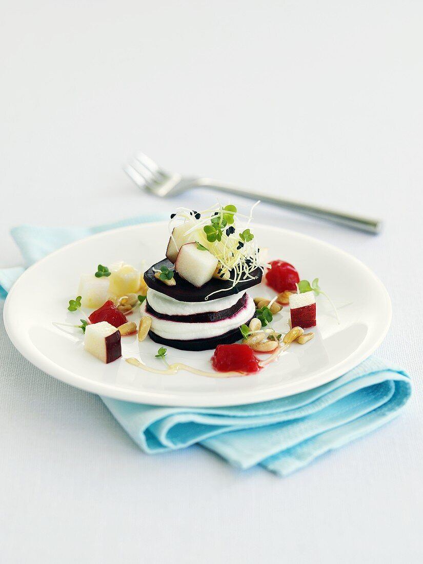 Tower of beetroot and soft cheese with cress