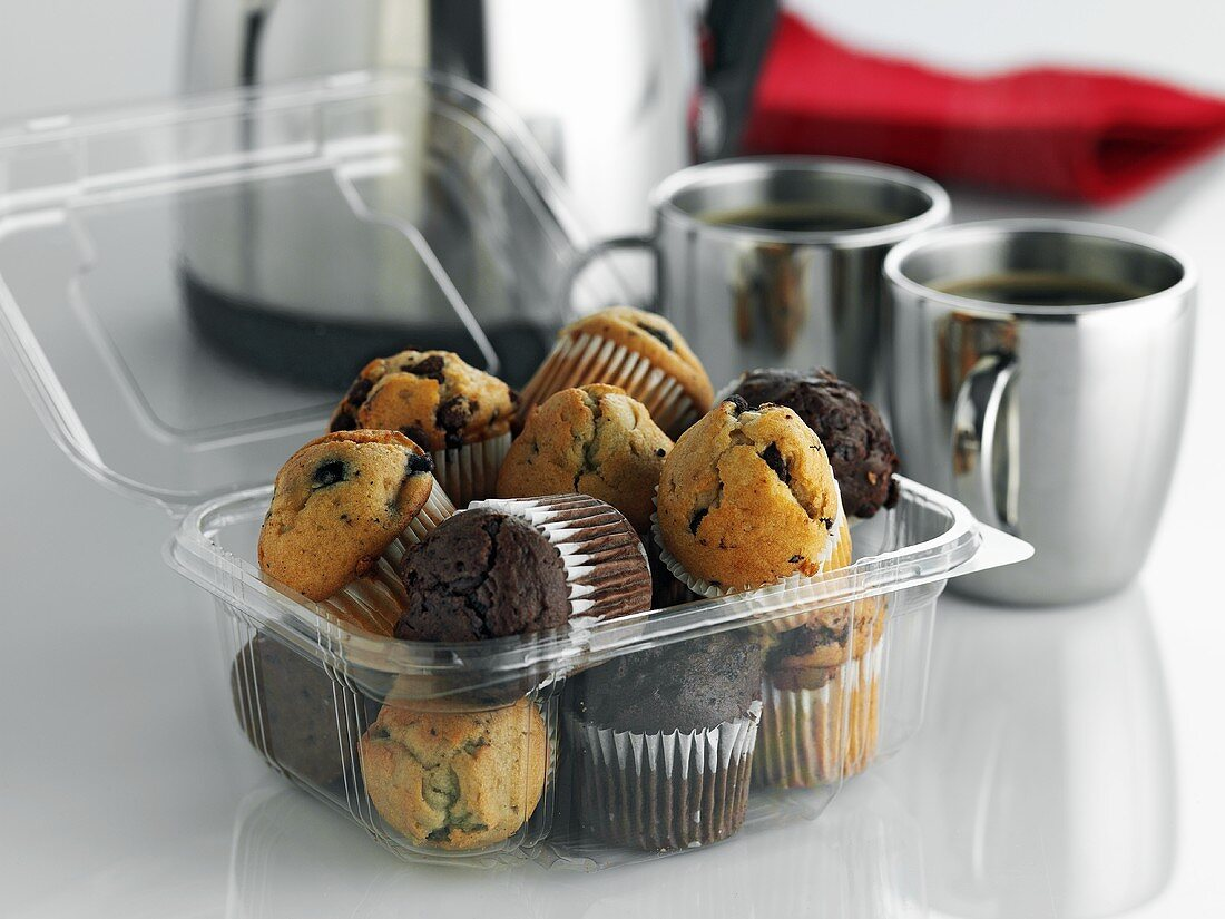 Mini-mufins in plastic container to take away, coffee