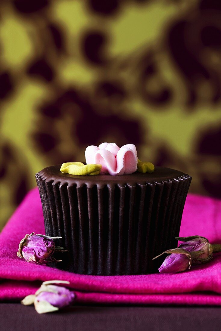 Elegant chocolate muffin with flower decoration