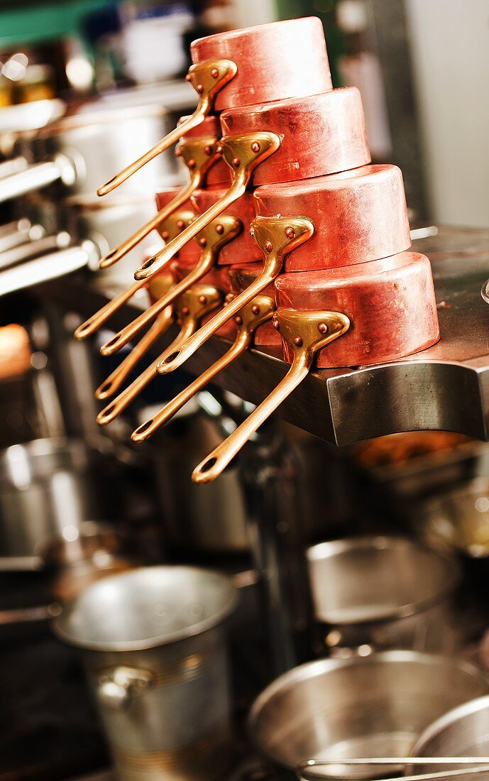Copper saucepans and other pans in a commercial kitchen