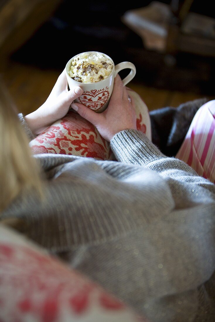 Woman holding cup of hot chocolate