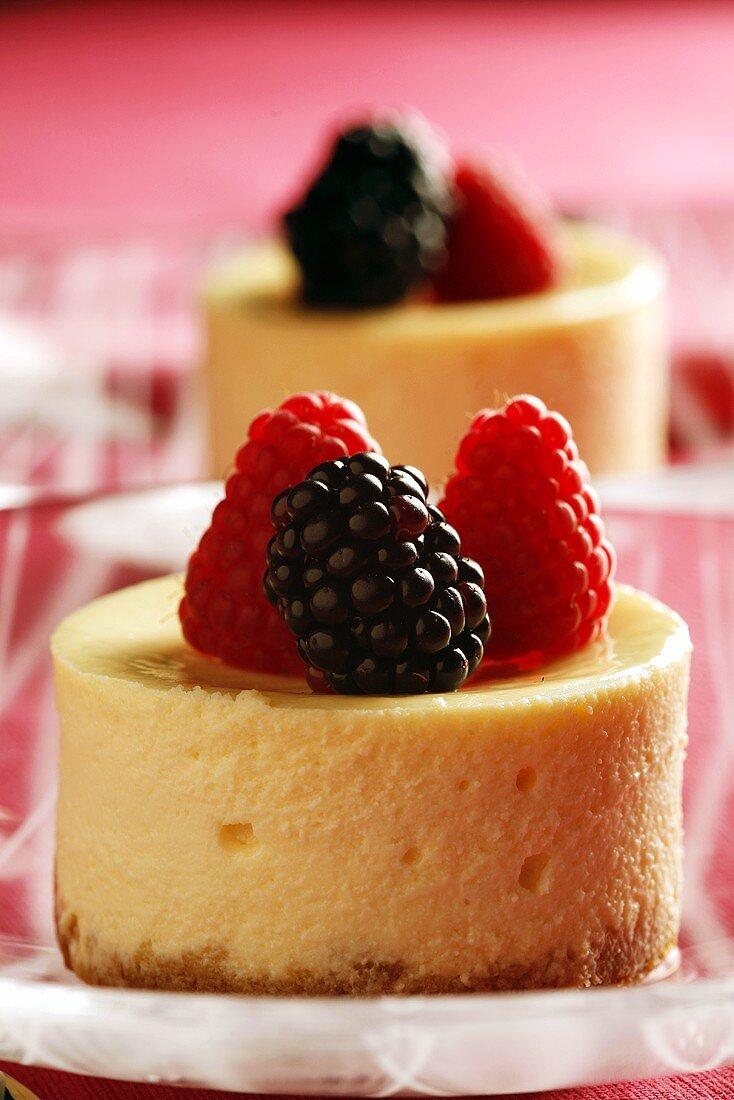 Individual cheesecakes with raspberries and blackberries