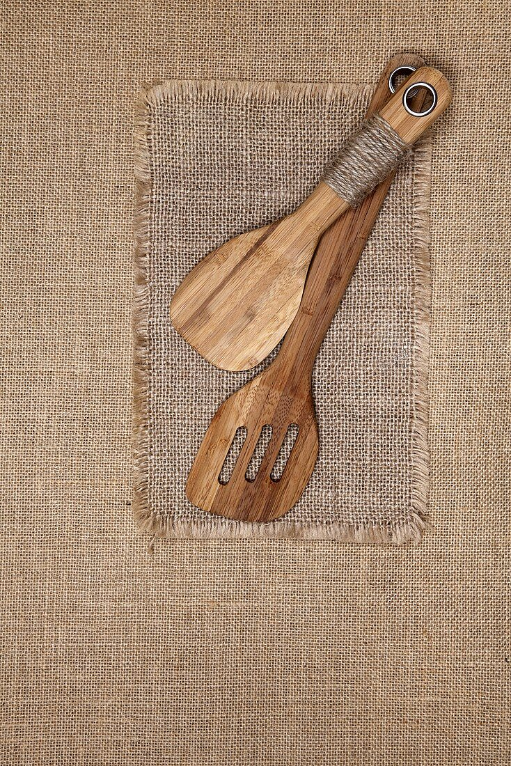 Wooden kitchen utensils on jute cloth