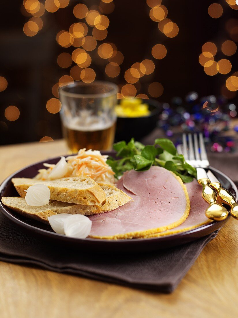 Ham with a honey crust, bread and silver onions for Christmas dinner