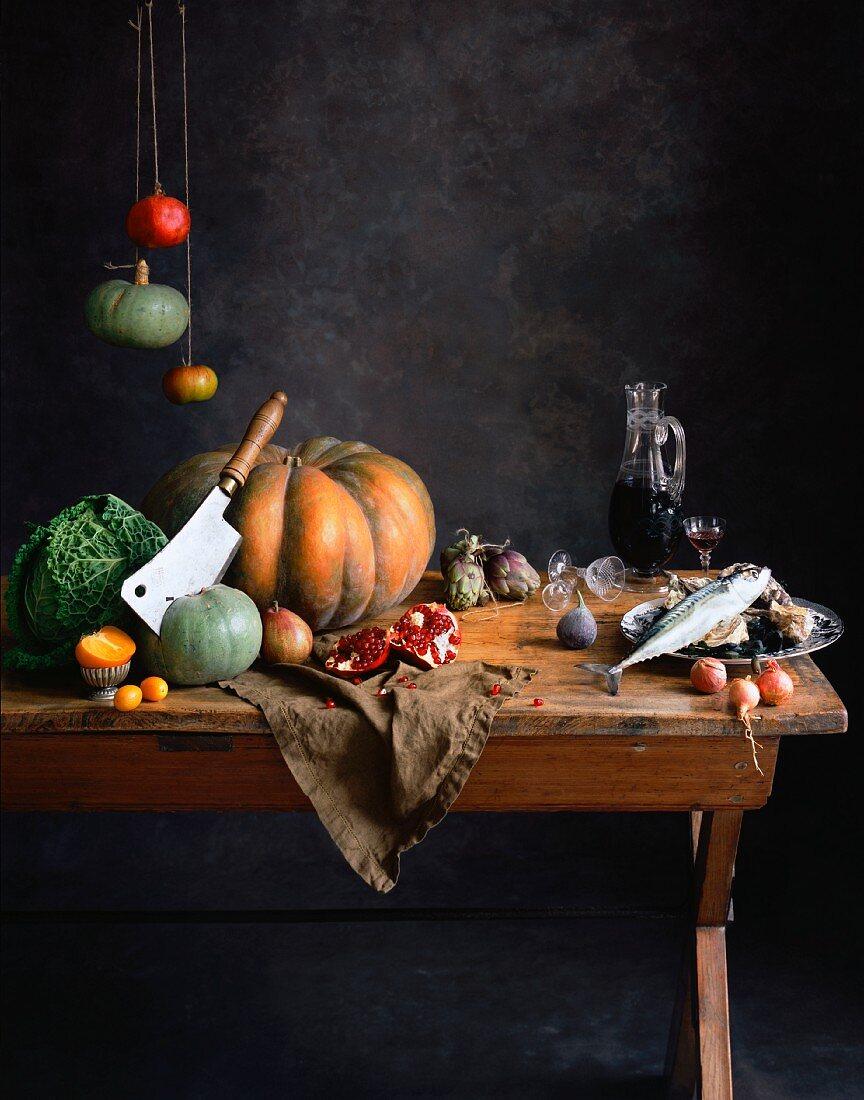 An arrangement with pumpkin, vegetables, pomegranate and fish