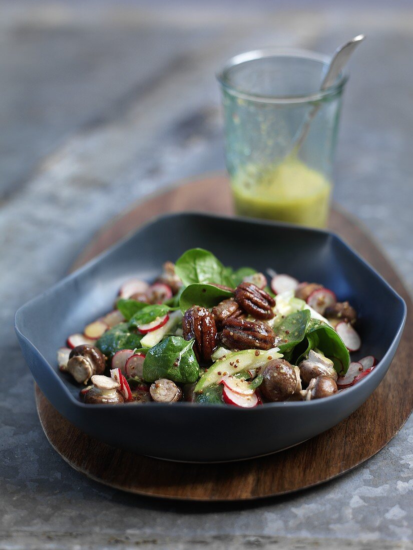 Baby spinach with spicy pecan nuts and a mustard dressing